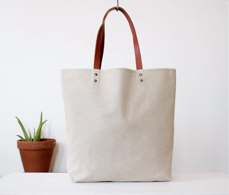 Natural white cotton fabric tote bag with leather strap